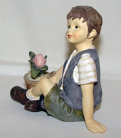 Image de Garçon avec fleur